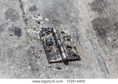 Old Steel Hinge On Concrete Ground.