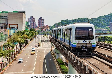 TAIPEI TAIWAN - JULY 09: This is the taipei mrt in new taipei city which has an overground line and goes through the rural areas of Taipei on July 09th 2014 in Taipei