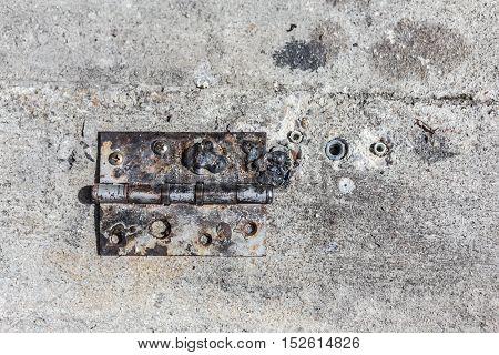 Old Steel Hinge On Concrete Ground.