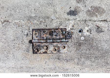 Old Steel hinge on concrete ground as street.