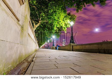 Riverside walking path at night in central London