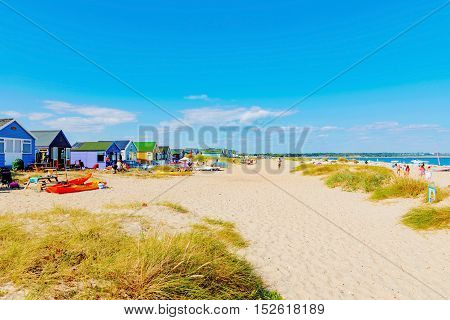 CHRISTCHURCH UNITED KINGDOM - AUGUST 22: This is Hengistbury head main beach where people come for vacations surfing and sailing on August 22 2016 in Christchurch