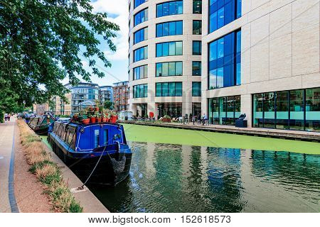LONDON - AUGUST 22: This is the Regents Canal in Kings Cross where many people go to take walks and some own boathouses on August 22nd 2016 in London
