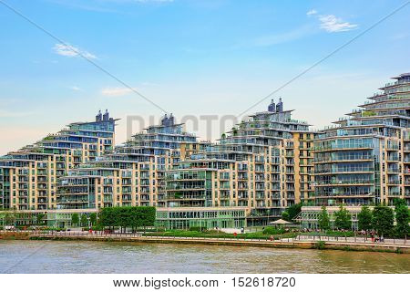 LONDON - AUGUST 25: These are modern waterfront apartment buildings which have recently been developed in Wandsworth on August 25th 2016 in London