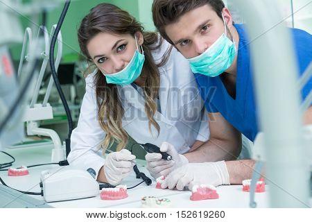 Dental Prosthesis, Dentures, Prosthetics Work. Prosthetics Hands While Working On The Denture, False