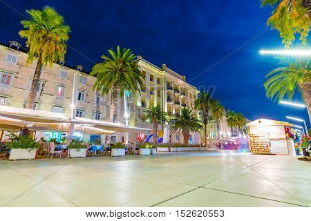 SPLIT CROATIA - SEPTEMBER 17: Old town center promenade in Split at night time with restaurnts where many tourists come to eat Seteptember 17 2016 in Split