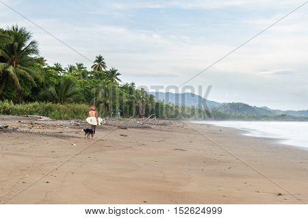 Surfer Walking On The Beach