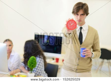 Young Angry Businessman Pointing His Watch As Concept Of Arrive Late At The Work At Modern Startup O