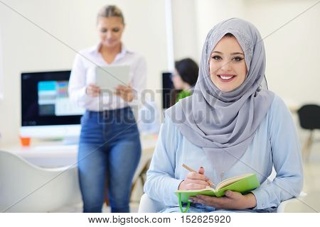Arabian Businesswoman In Startup Office With Team Working In The Background, Arabian Woman Wearing H
