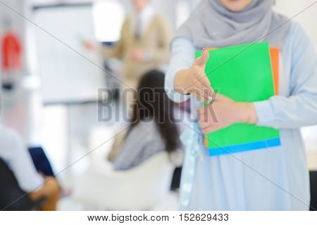 Arabic business woman working in team with her colleagues at startup office