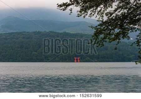 Red Torii Gate In Lake Water