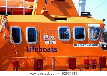 WEYMOUTH, UNITED KINGDOM - JULY 18, 2016 - Orange RNLI lifeboat in the harbour Weymouth Dorset England UK Western Europe, July 18, 2016.