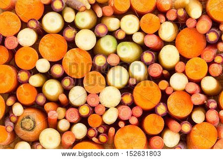 Colourful Background Of Assorted Sliced Carrots
