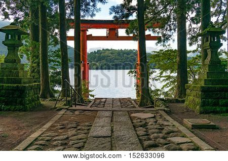 Bright Red Torii Gate On The Lake Ashi