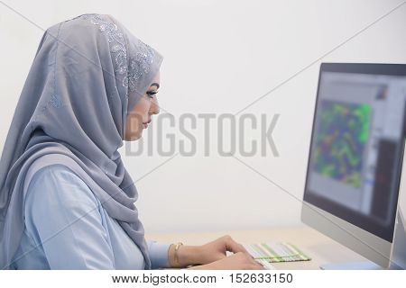 Attractive Muslim Young Woman Working In Office On Computer