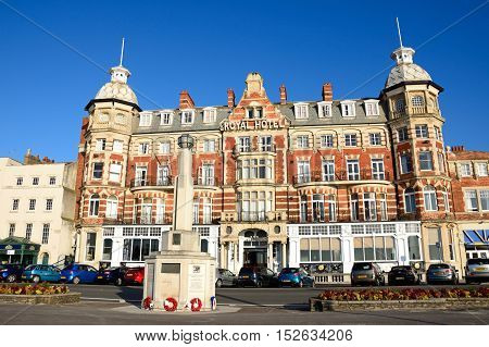 WEYMOUTH, UNITED KINGDOM - JULY 19, 2016 - View of the Victorian Royal Hotel along the Esplanade promenade with a war memorial in the foreground Weymouth Dorset England UK Western Europe, July 19, 2016.