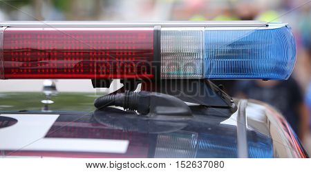 Flashing Lights On The Police Car On Patrol In The City