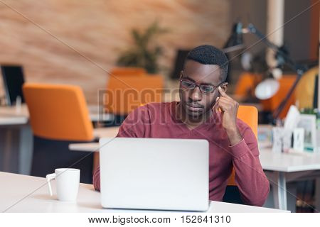 Handsome Successful African American Looking At The Screen With Serious Face Expression At Modern St
