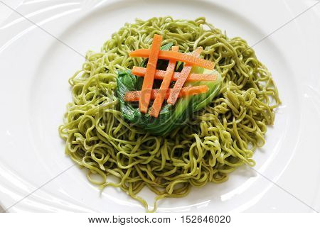 Delicious vegetable instant noodle on white plate