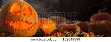 Halloween Pumpins With The Smoke Around Them