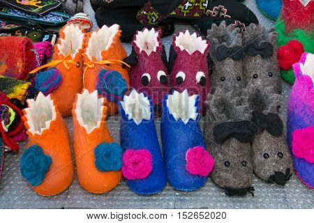 Handmade colorful wool slippers or shoes for sale at street in Tbilisi, Georgia, Europe.