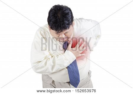 Image of businessman having heart attack isolated on the white background