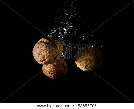 high speed photography walnuts splash in water healthy nutshell broken