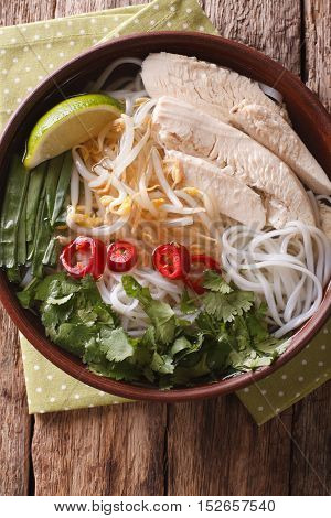 Vietnamese Soup Pho Ga With Chicken And Rice Noodles Close-up. Vertical Top View