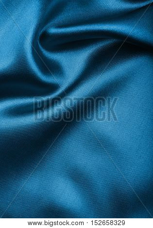 Smooth Elegant Blue Silk Or Satin Texture As Abstract Background. Luxurious Christmas Background Or