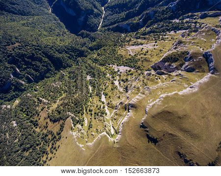 Top View Of The Precipice And The River In A Mountain Valley