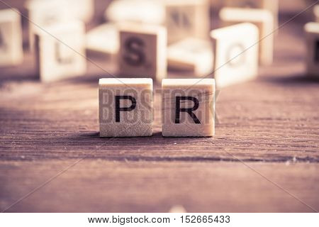Business conceptual word PR collected of of wooden elements with the letters