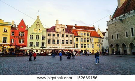 TALLINN ESTONIA - AUGUST 31 2016: Old buildings restaurants and cafes of the Town Hall square in old historical area in the popular European city of Baltic region