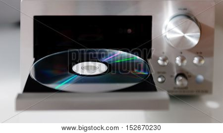 Hi-Fi cd player with Audio CD compact disk in open tray ready to listen to digital stereo music sound