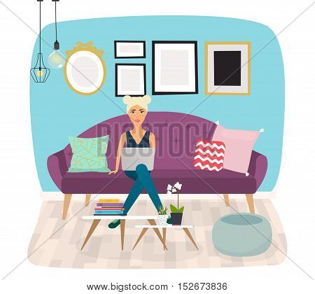 Girls working at home. Young woman sitting on a sofa and using laptop. Freelance self employed freedom in living room.