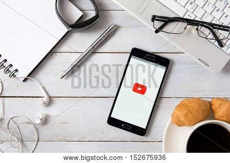 WROCLAW POLAND - OCTOBER 14th 2016: Samsung A5 with YouTube application laying on desk. YouTube allows users to upload view rate share and comment on videos