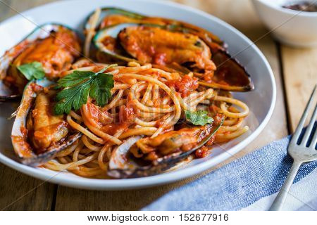 Spaghetti with Mussel in tomato and herbs sauce