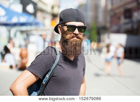 Young Man Hipster In Sunglasses