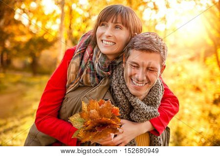 happy autumn fall couple embracing eachother