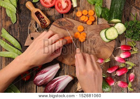 woman cutting raw vegetable