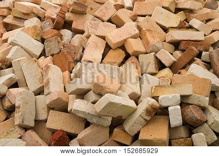 A lot of used bricks is lying big pile