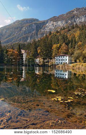 Lago di Cei (Cei Lake) small alpine lake in Italian Alps in autumn. Trento Trentino Alto Adige Italy Europe