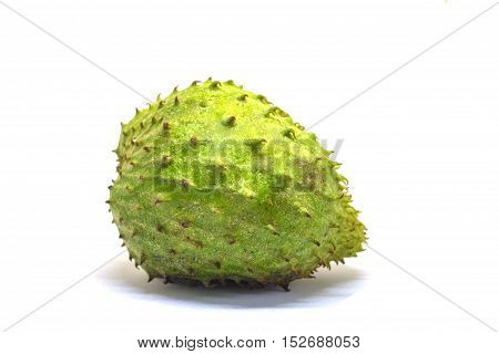 Soursup or soursop isolated on white background. Guyabano photo in lightbox. Unusual tropical fruit with green color and needle skin. Sweet tropical dessert. Sugar apple exotic fruit. Eatable pine