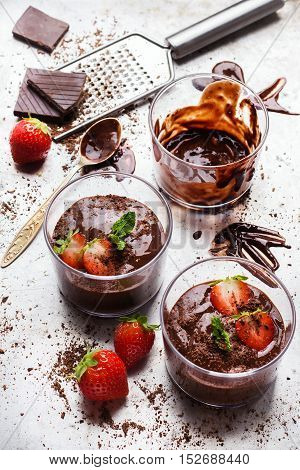 Food and drink, dessert sweet concept. Chocolate mousse with mint and strawberries in glass on rustic table. Selective focus poster