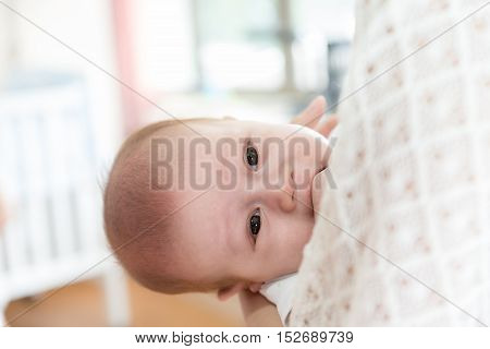Picture of baby boy after cry while mother hug baby. Closeup infant baby.