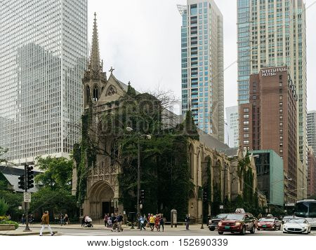 Chicago IL USA - September 25 2015: Fourth Presbyterian Church stands between modern buildings in the city of Chicago.