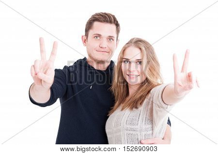 Happy Handsome Couple Showing Peace Gesture