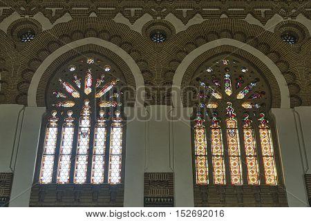 TOLEDO, SPAIN - JULY 17, 2016: Toledo (Castilla-La Mancha Spain): interior of the historic railway station. Stained glass windows