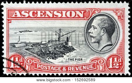 LUGA RUSSIA - JUNE 25 2016: A stamp printed by ASCENSION shows image portrait of King George V against view of the Georgetown Pier circa 1934.