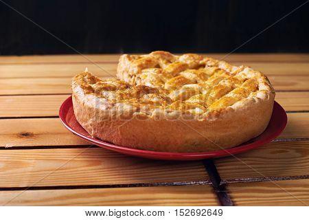 Pie with chicken on a dark background. Dark photo. Minimalism