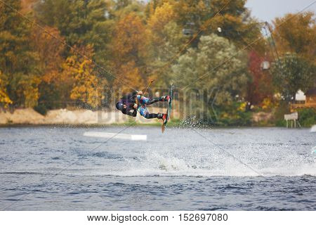 Kiyv Ukraine - October 02 2016: The training of kite surfers on the lake in autumn city